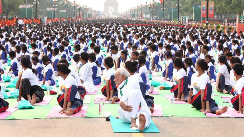 Prime Minister Narendra Modi participates in the mass yoga demonstration at Rajpath on the occasion of International Yoga Day 6