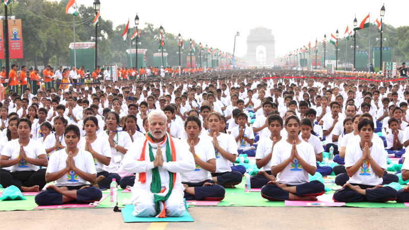 Prime Minister Narendra Modi participates in the mass yoga demonstration at Rajpath on the occasion of International Yoga Day1